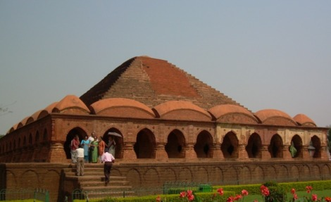 Rasmancha with its unique architectural manifestations was built by Bir Hambir in 1600 AD. The temple stands on a raised square Laterite plinth with a pyramidal superstructure. Its parallel has not been found elsewhere in India and it may be considered as the pride of Bishnupur for its unique shape.