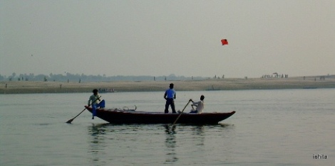 Kids flying kite on the Ganges in Varanasi